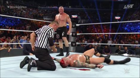 Brock Lesnar Bloodies Randy Orton