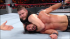 Owens has Rollins in a chinlock